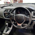 Steering wheel push pull handle