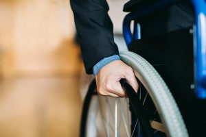 wheelchair user in a suit